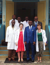 Course Director Dr. Esther Cubo (in red) gathers with participants.