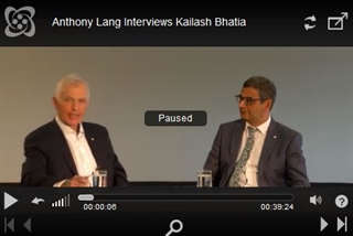 Anthony Lang, left, interviews Kailash Bhatia in Berlin in June 2016.