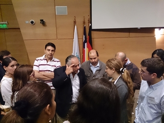 Participants enjoy an opportunity to speak with Dr. Federico Micheli from Buenos Aires, Argentina.