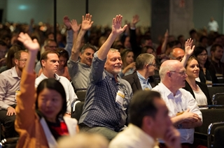 Members of the audience wait to be called at the 20th International Congress of Parkinson's Disease and Movement Disorders in Berlin, Germany. Photo: Jens Jeske