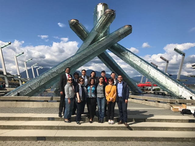 MDS LEAP participants gather in front of the Olympic Cauldron in Vancouver, BC, Canada, in June 2017.  Photo by Prashanth LK