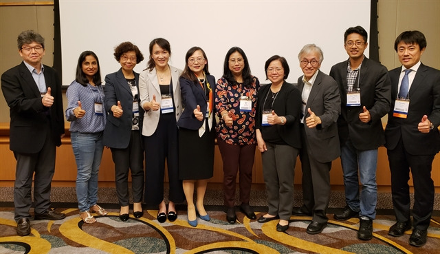 The MDS-AOS Education Committee poses for a picture at the International Congress in Hong Kong in October 2018.