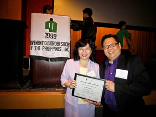 Ruey-Meei (Robin) Wu, MD, PhD, left, and Raymond Rosales, MD, PhD pose for a photo.