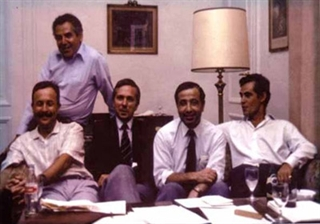 L to R: Founding leaders Eduardo Tolosa, Stanley Fahn (seated behind), Andrew Lees, Joseph Jankovic, C. David Marsden. Hamburg, Germany, September 1985. Photo credit: Cathy Jankovic