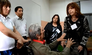MDS member Dr. Irene Litvan, right, meets with a patient in Santiago, Chile.